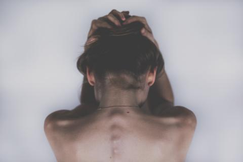 Woman's back with defined vertebrae